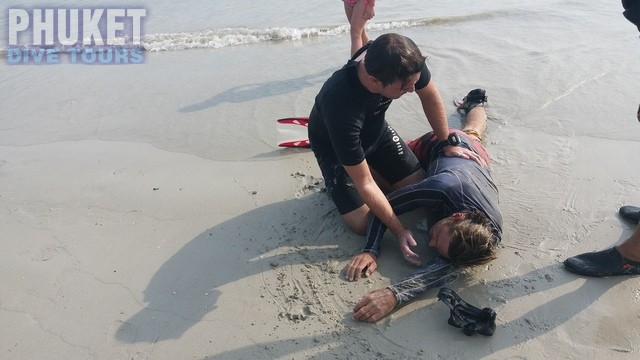 Rescue diver places the victim into the recovery position